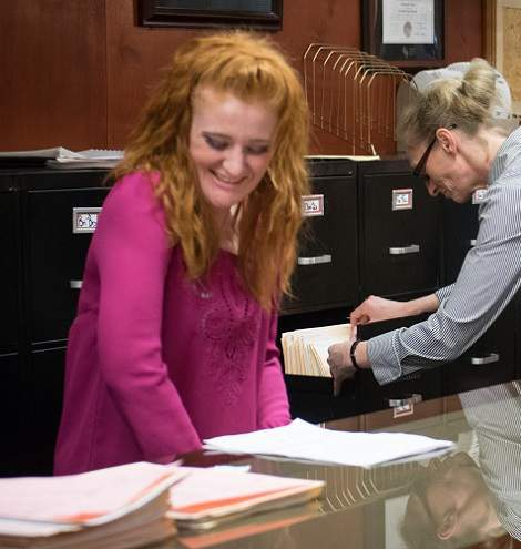 Christina Franz pulling client files the evening before the client is scheduled to come in.
