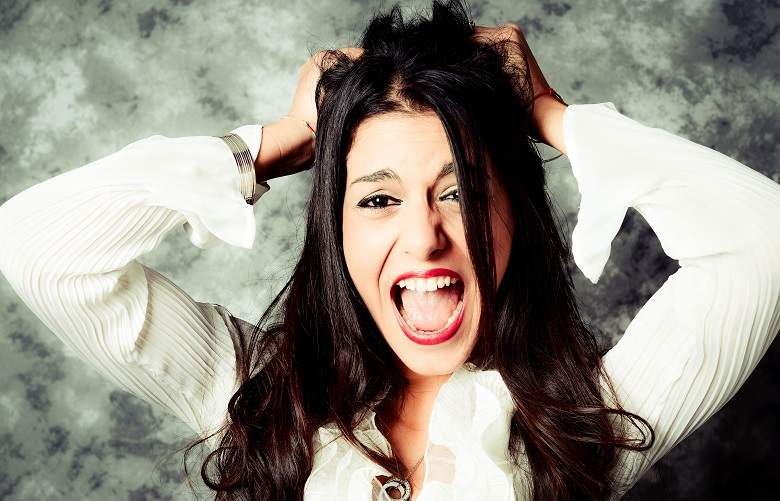 woman with tax problems pulling her hair out