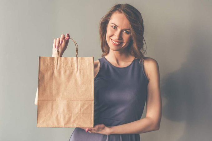 woman with brown paper bag